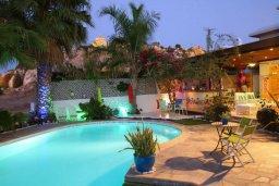 Территория. Кипр, Санрайз Протарас : Живописный коттедж с 3-мя спальнями, окруженный экзотическими пальмами с великолепным видом на море и плавательным бассейном