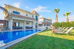 Кипр, Каппарис : Шикарная вилла с великолепным видом на море, с 4-мя спальнями, с бассейном и просторной зелёной территорией с патио и барбекю
