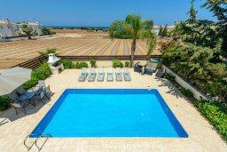 Бассейн. Кипр, Каппарис : Роскошная вилла с видом на море, с 3-мя спальнями, с бассейном и солнечной террасой с патио и барбекю