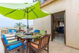 Обеденная зона. Кипр, Ионион - Айя Текла : Прекрасная вилла с бассейном возле пляжа, 3 спальни, 2 ванные комнаты, барбекю, парковка, Wi-Fi
