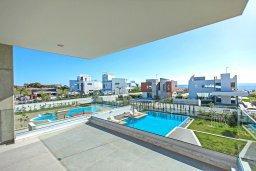 Вид на море. Кипр, Аммос - Лимнария Бич : Шикарная современная вилла с видом на Средиземное море, с 3-мя спальнями, с бассейном и джакузи, солнечной террасой с патио и барбекю, расположена в 70 метрах от пляжа