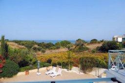 Вид. Кипр, Лачи : Замечательная вилла с прекрасным видом на залив Chrysochou, с 3-мя спальнями, с бассейном, уютной террасой с патио, в окружение красивого ландшафтного сада