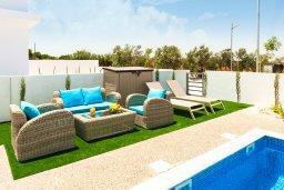 Патио. Кипр, Каппарис : Современная вилла с видом на Средиземное море, с 3-мя спальнями, 2-мя ванными комнатами, бассейном, тенистой террасой с патио, lounge-зоной, барбекю, расположена в тихом районе Kapparis