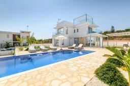 Вид на виллу/дом снаружи. Кипр, Каво Марис Протарас : Потрясающая современная вилла с террасой на крыше с видом на Средиземное море, с 3-мя спальнями, с бассейном, тенистой верандой с патио и барбекю, расположена в популярном районе Green Bay