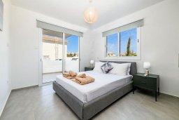 Спальня. Кипр, Каппарис : Очаровательный апартамент с 2-мя спальнями, расположен в комплексе с бассейном, теннисным кортом и спортивной площадкой