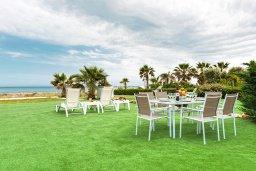 Территория. Кипр, Ионион - Айя Текла : Очаровательная вилла с шикарным видом на Средиземное море, в окружении зелёного сада, с 3-мя спальнями, солнечной террасой с патио и барбекю, расположена на побережье в Ayia Thekla