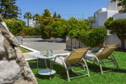 Зелёный сад. Кипр, Фиг Три Бэй Протарас : Очаровательная вилла в греческом стиле с 4-мя спальнями, тенистой террасой с патио и барбекю, расположена недалеко от пляжа Fig Tree Bay