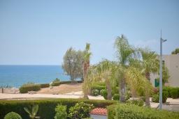 Вид на море. Кипр, Корал Бэй : Потрясающая вилла с видом на Средиземное море, с 3-мя спальнями, с бассейном, в окружении пышного зелёного сада, тенистой террасой с патио и барбекю, расположена недалеко от пляжа Coral Bay Beach