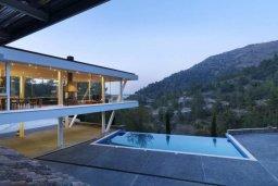 Вид. Кипр, Какопетрия : Эксклюзивная роскошная вилла с 5-ю спальнями, большим частным бассейном с подогревом, тренажерным залом, расположена в окружении пышного соснового леса