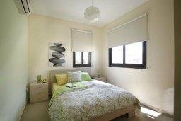 Спальня. Кипр, Каппарис : Таунхаус с 2-мя спальнями и патио, в комплексе с открытым бассейном, спа-центром и тренажерным залом