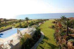 Кипр, Аргака : Роскошная вилла с видом на море, с 4-мя спальнями, с бассейном,  сауной, массажным кабинетом, расположена в Полисе