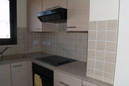 Кухня. Кипр, Каппарис : Апартамент с гостиной, тремя спальнями, двумя ванными комнатами и балконом, в комплексе с общим бассейном, Spa-центром и тренажерным залом