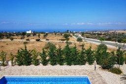Вид. Кипр, Куклия : Прекрасная вилла с бассейном и зеленым двориком, 4 спальни, 2 ванные комнаты, барбекю, парковка, Wi-Fi