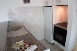 Кухня. Кипр, Айос Тихонас Лимассол : Светлые односпальные апартаменты для 3 гостей с очаровательным видом на море
