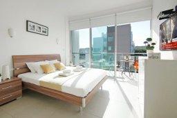 Спальня. Кипр, Фиг Три Бэй Протарас : Апартамент в 100 метрах от пляжа, с двумя спальнями, двумя ванными комнатами и балконом, в комплексе с бассейном, тренажерным залом и теннисным кортом