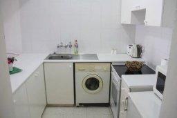 Кухня. Кипр, Пафос город : Апартамент с гостиной, двумя спальнями и баклном